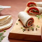 everything toufayan salmon wrap on wood cutting board
