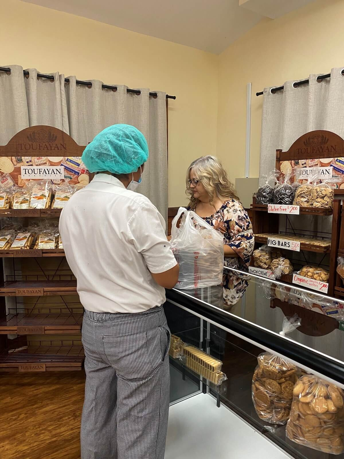 customer purchasing baked goods from store